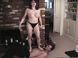 Busty brunette mom in black undies stuffing her feet into dudes mouth