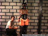 Woman in tight corset with fat hips got her tits bound