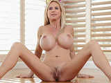 Blonde mature rubbing lads dong between her huge boobies and takes semen on them