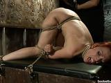 Busty redhead MILF enjoys in rough bondage session