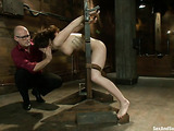 Bald man fucks a brown haired babe in bondage