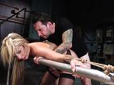 Inked slut in bondage gets her both holes banged so hard