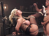 Busty blonde bimbo in stockings gets tied up and banged