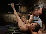Brunette and a blonde in bondage getting rammed by a stud