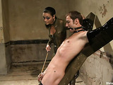 Dark-haired lady bound the skinny pal in the dungeon