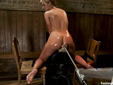 Oiled chick spreads the legs to welcome a powered dildo