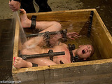 Amateur slut surprisingly gets bound in a small wooden box