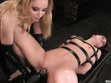 Blonde slut in black leather loves to tease her redhead slave