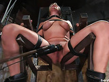 Wild blondie in bondage teasing her both holes with toys
