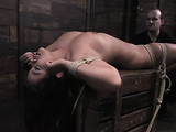 Busty brunette slut gets tied up and gagged by her master