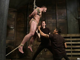 Muscled dude in bondage gets used by two kinky gay men