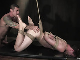 Ropes and candles made a special atmosphere for BDSM act