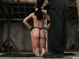 Brunette doll and her red friend having an experiment in cuffs and chains in a real bdsm dungeon