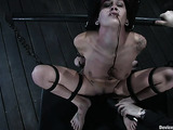 Hogtied tattooed brunette gets caned and tortured with chains