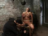 Brunette MILF bimbo in bondage gets used by her master