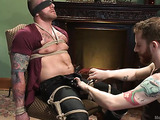 Gay hunk with a tattooed body gets tied up and used