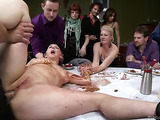 Busty ponytailed brunette gets disgraced and fucked roughly on the table before stuffed guests