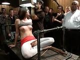 Red and blonde sluts gets poked in public in bondage device