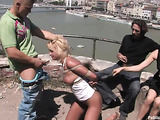 Leashed blonde gal with a gag-ball led on the street spanked and fucked in public