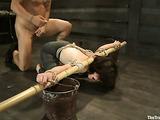 Short haired brunette sluts in bondage sucks a large meat pole