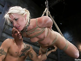 Tied up blondie sucks a big dick and gets rammed from behind