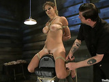 Blonde whore in bondage rides a sybian with pleasure