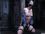Sexy brunette in a short skirt gets tied up and used