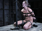 Freaky blonde woman in bondage gets her tight pussy stimulated