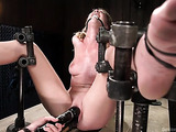 Petite blonde gal in bondage enjoys in sex toys
