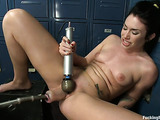 Brunette in the locker room gets her tight pussy stimulated