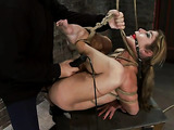 Tied up blonde porn star with huge tits enjoys in rough session