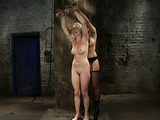 Raunchy blonde porn whore in bondage enjoys in this scene