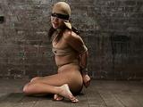 Masked Asian slut in bondage needs to suck a huge pecker