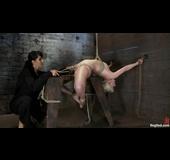 Nasty brunette mistress fucks her blonde slave in bondage