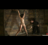 Tattooed black lady shows off her body and gets tied up