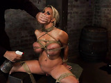 Hogtied blonde bimbo gets her big tits stimulated