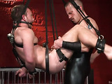 Cruel master in leather fucks his tied up slave
