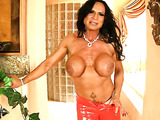 Raven-haired hottie shows off hard body and firm tits in red latex