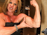 Wild babe shows off her big strong muscles and takes off sexy little dress