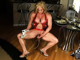 Blonde with hard muscular body, pumps up and strokes already big clit