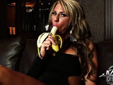 Strong woman displays her blow job skills by licking and sucking on banana