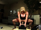 Blonde body builder in sexy thigh-highs has new experience riding Sybian