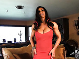 Muscular hottie in red dress shows off round tits and masturbates with vibrator