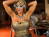 Stunning masked girl who is ripped pleasures herself on a chair