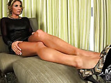 Tall lady with round tits in high heels fingers her fuckbutton