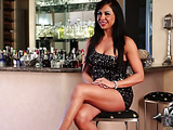 Lithe but thick woman wearing sparkly dress is interviewed about sex and work