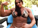 Muscle hottie hangs by pool showing off hard body and big clit