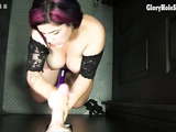 Thick mature woman gives her jaw and forearms a workout on some cock machines