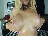 Gorgeous blond plays with her massive tits before getting a cock drilling and cum facial