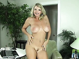 Busty blond sucks big cock with a cock-ring before having him shoot all over her stunning ass